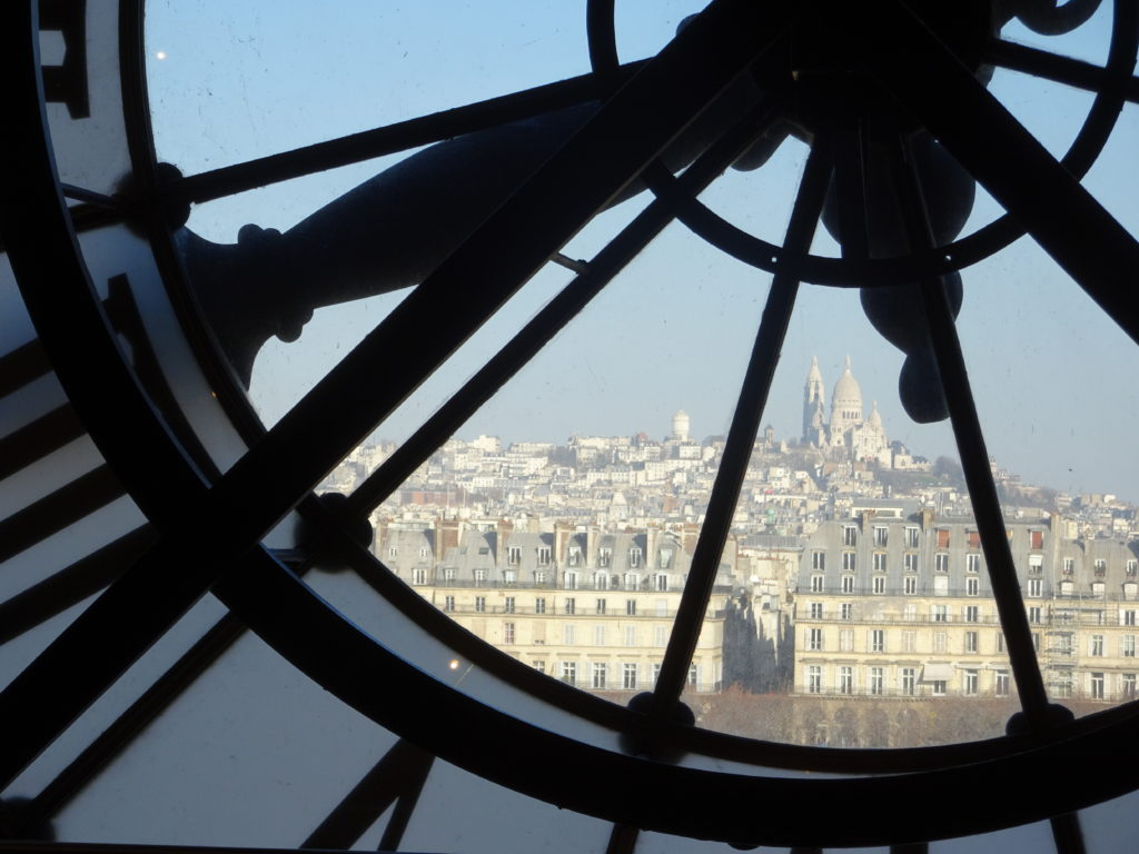 Sacre Couer, as seen through the back of the clock at Musee D'Orsay