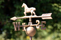 Weathervane showing North, South, East, West, with a horse on top of an arrow