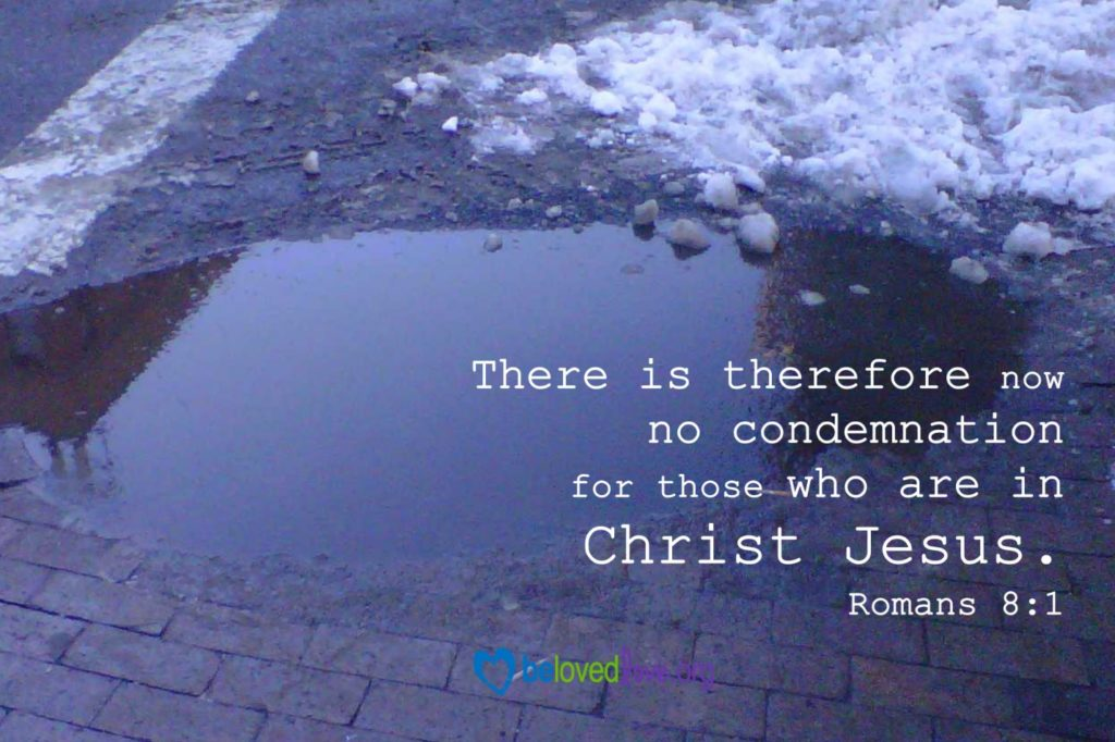 "A small pool of dirty water in a parking lot, with melting snow adjacent.  Caption says, ""There is therefore now no condemnation for those who are in Christ Jesus.  Romans 8:1"