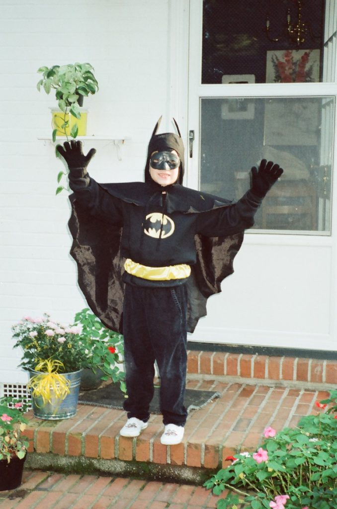 child in a batman costume