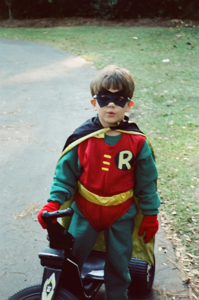 little boy in a Robin costume