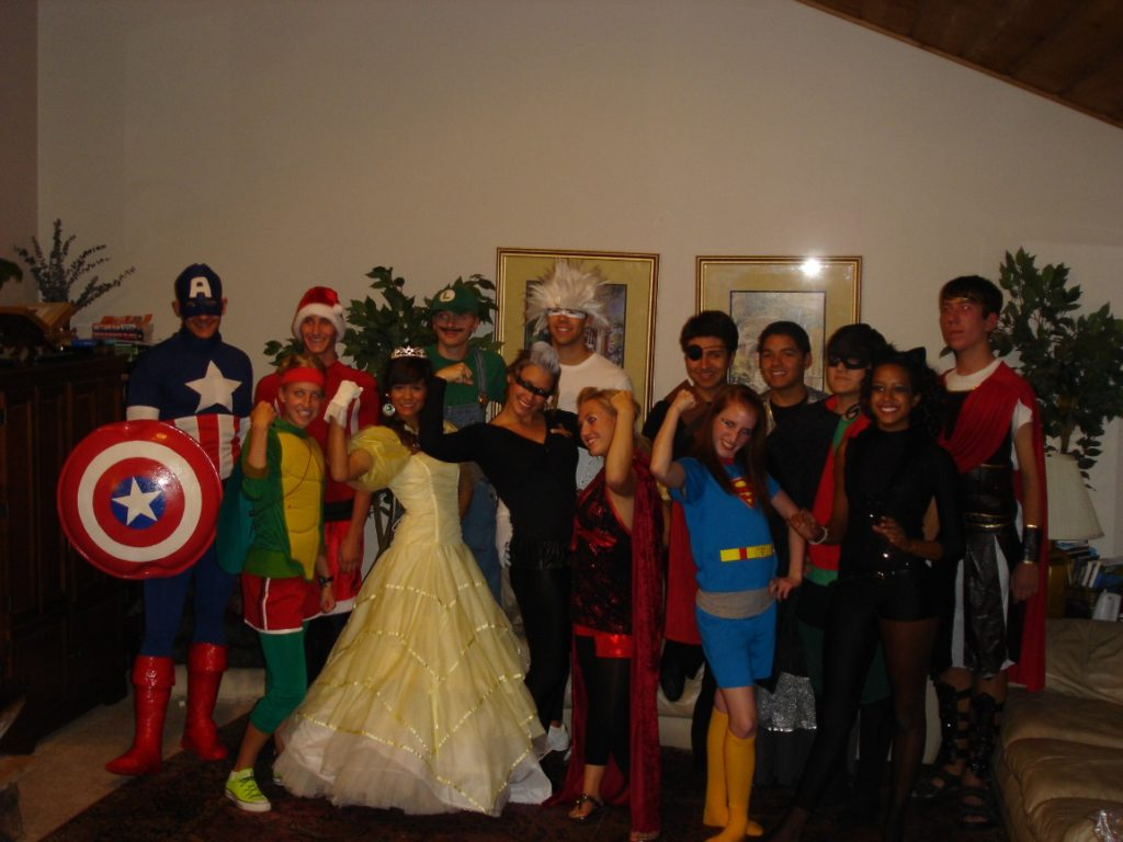 crowd of teenagers in superhero costumes