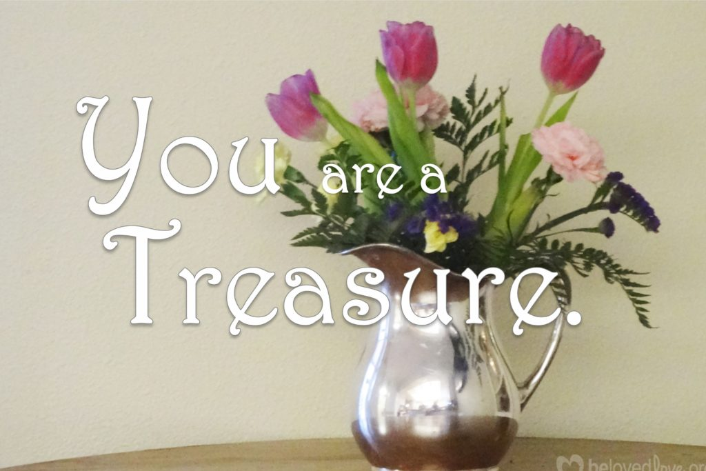"""You are a Treasure"", words over a silver pitcher of flowers"